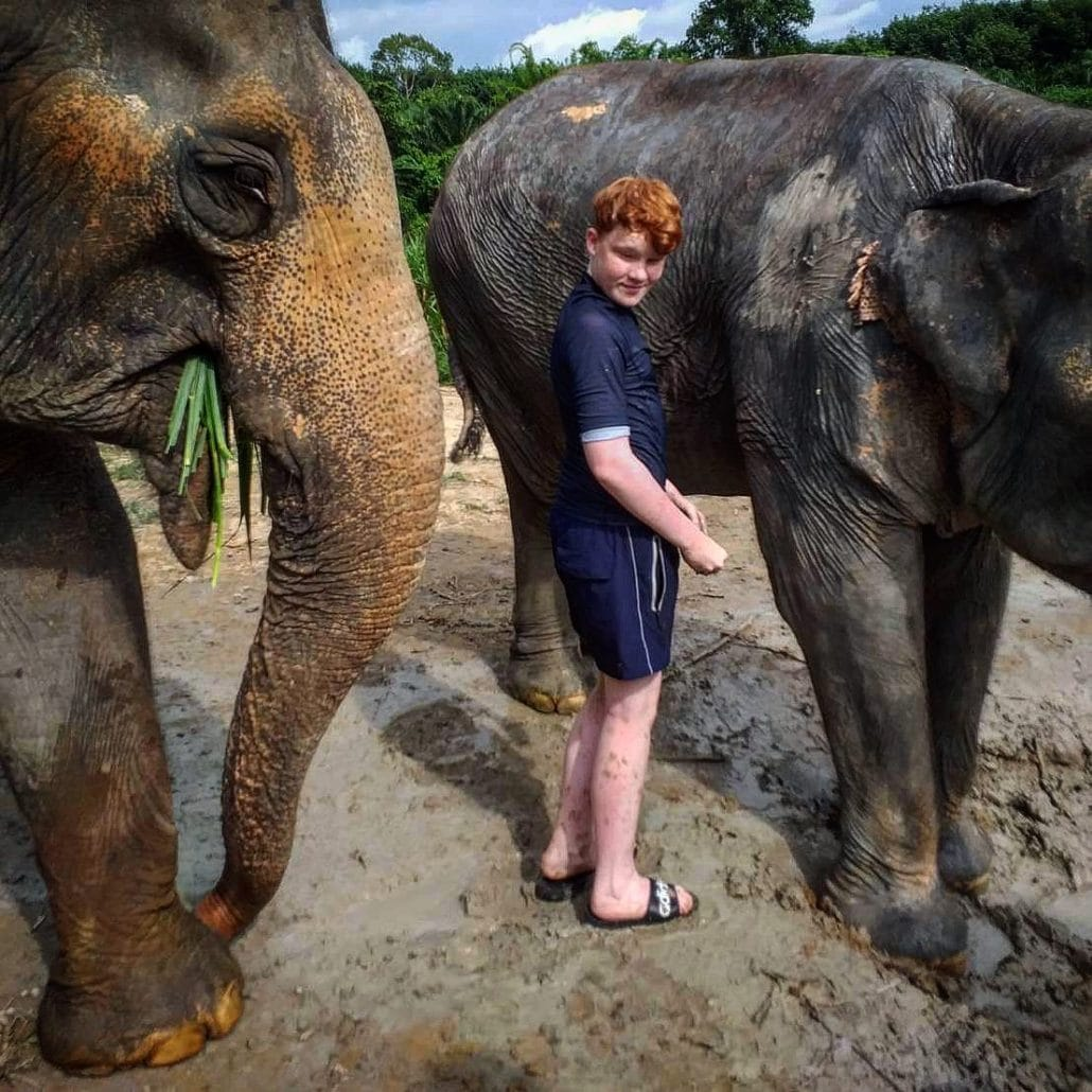 Krabi Elephant HOUSE Sanctuary, a boy and elephant